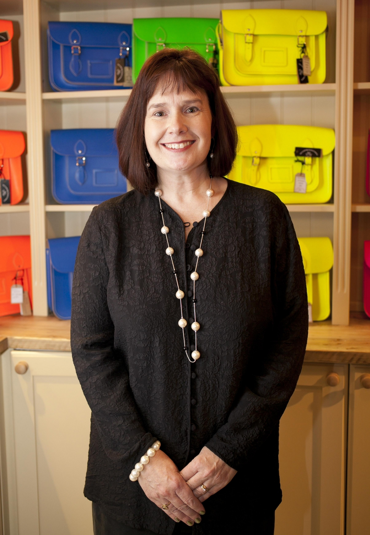 Starting off as a homemade venture, in mother-of-two Julie Deane's kitchen with the help of her mother Freda Thomas and a modest £600 budget, The Cambridge Satchel Company was created.