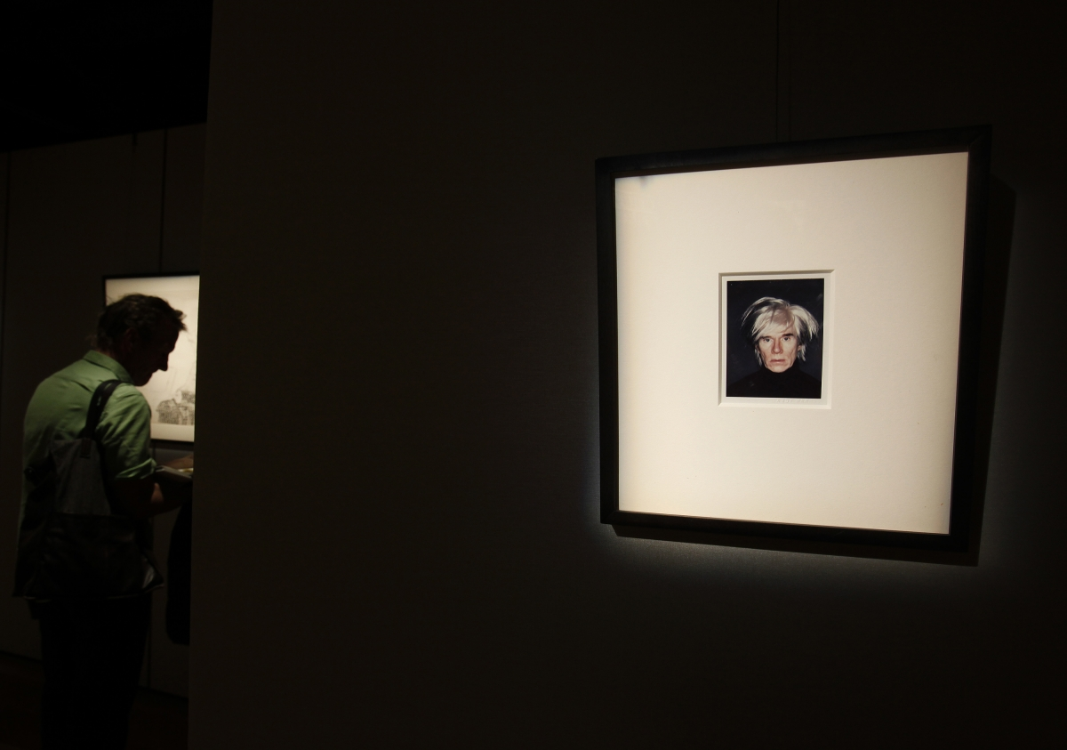 A polaroid self-portrait by US artist Andy Warhol, stamped with his name, displayed at Sotheby's Hong Kong Gallery September 11, 2013