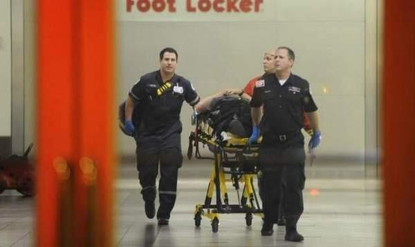 Police remove the injured from a Maryland Mall where a killer is on the loose