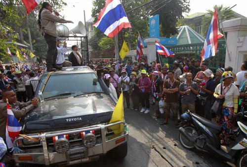 Anti-government protesters gather outside a polling station in central Bangkok