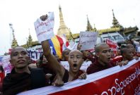 Buddhist monks and other people protest against a visit to Myanmar by a high-level delegation from the Organization of Islamic Cooperation