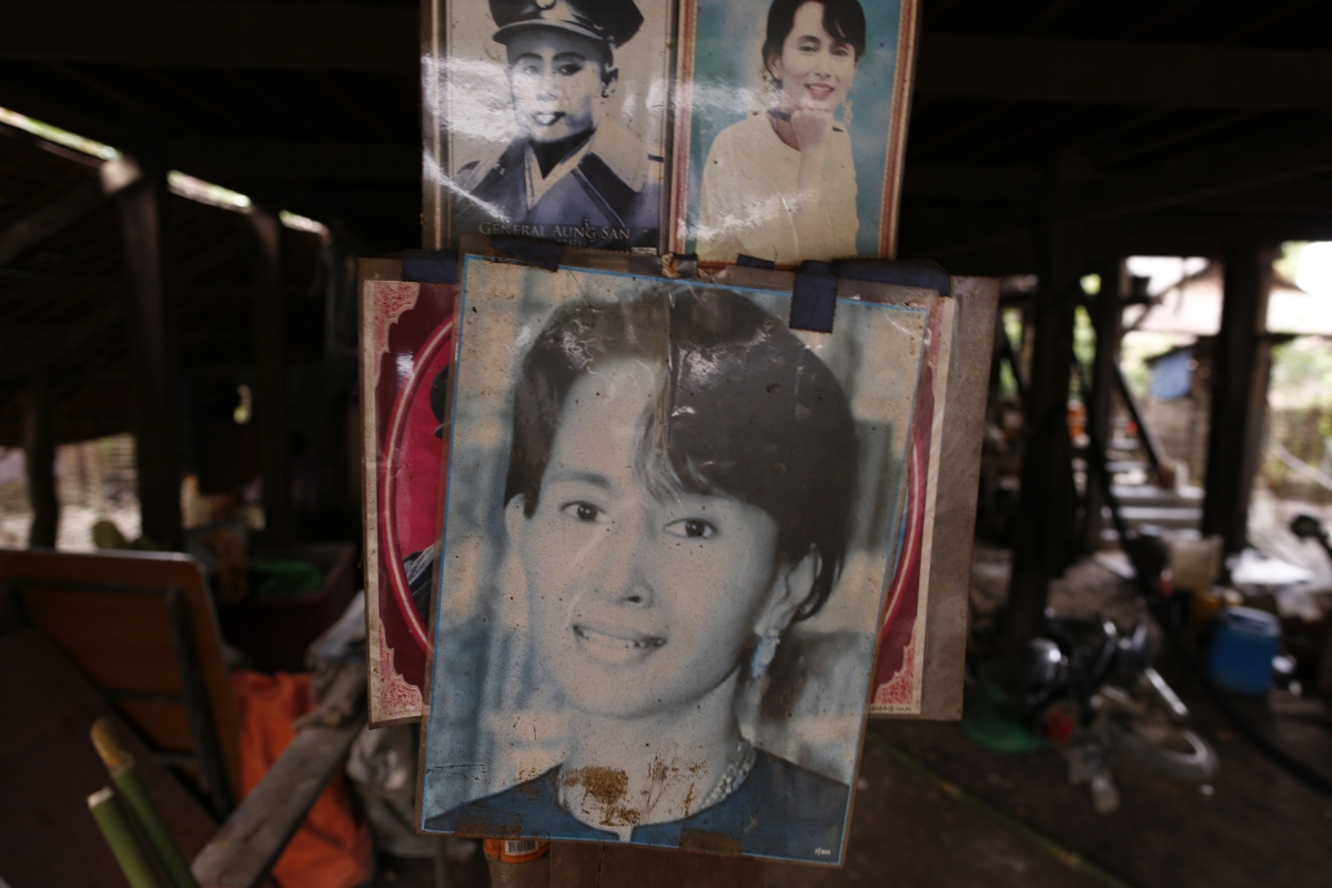 Portraits of Aung San Suu Kyi and her father Aung San are seen in a National League for Democracy branch office that was thrown into disarray during violence at Shwe Lay village, outside of Thandwe in Rakhine state