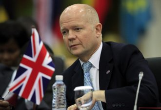 UK's Foreign Secretary William Hague urges Thailand to embrace democracy