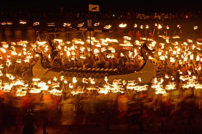 up helly aa long boat torches blur
