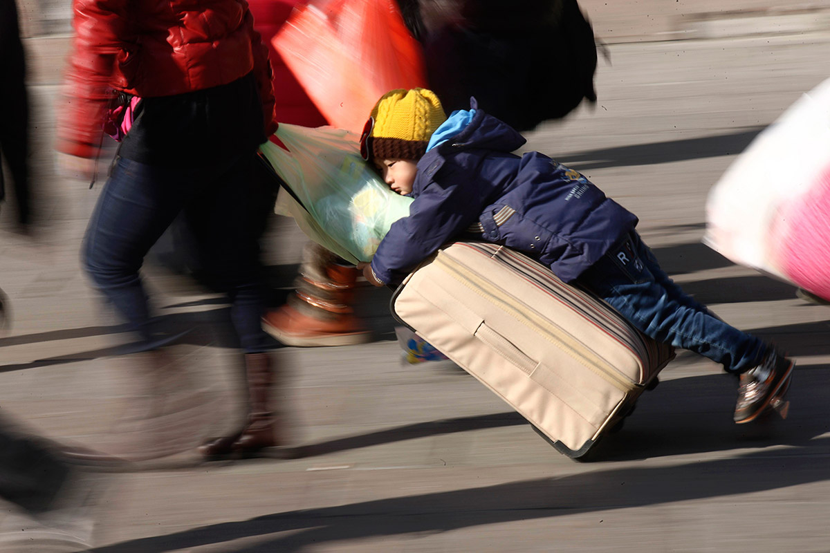 child on luggage