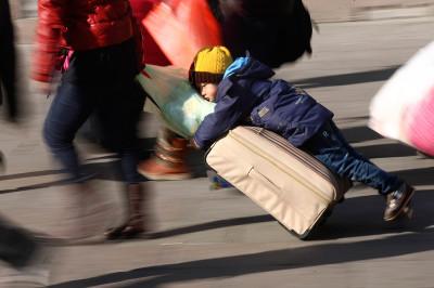 child on luggage