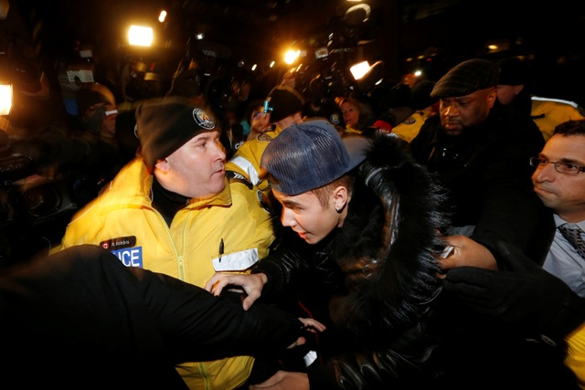 Pop singer Justin Bieber arrives at a police station in Toronto January 29, 2014.