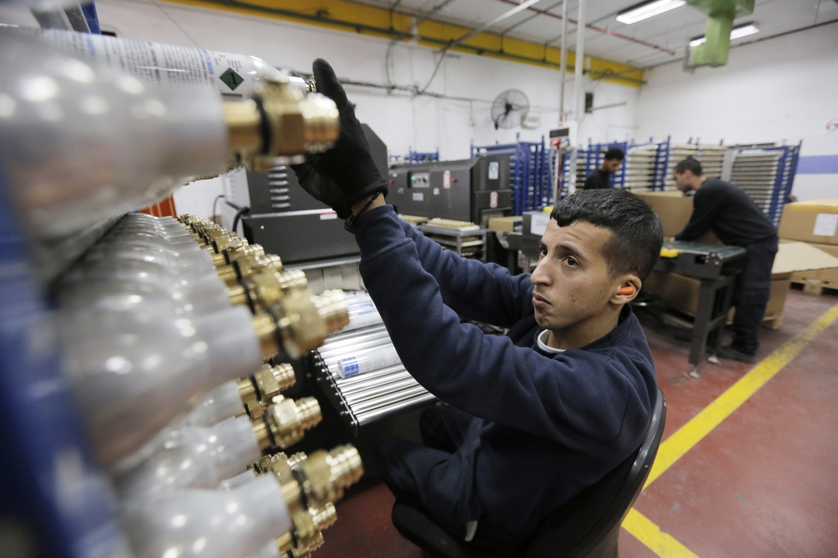 A Palestinian employee works at the SodaStream factory in the West Bank Jewish settlement of Maale Adumim