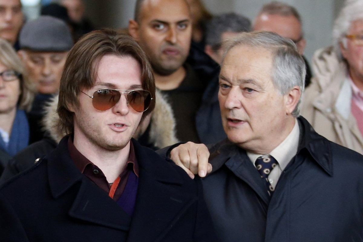 Raffaele Sollecito (L) with his father Francesco outside court in Florence, ahead of the Meredith Kercher murder trial verdict
