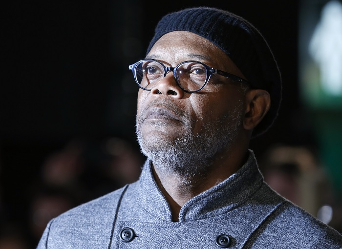 """Samuel L Jackson said Oscar-nominated film 12 Years A Slave avoids the """"real issue"""" of racism in Hollywood."""