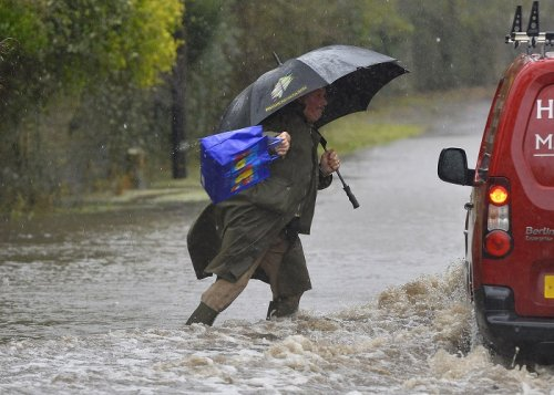A resident wades through flooded parts of the Somerset Levels in southwest England.