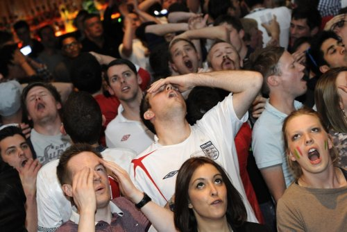 England fans in a London pub watching england's defeat to Italy in the quarter finals of ther 2012 European Championship.