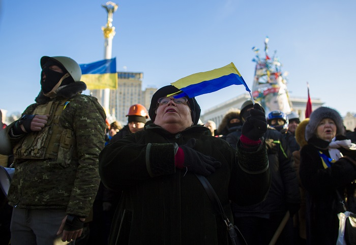 Anti-government protesters sing the Ukrainian national anthem during a rally at Independence Square in Kiev.