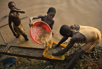 Gold mining in DRC young boys pan for gold