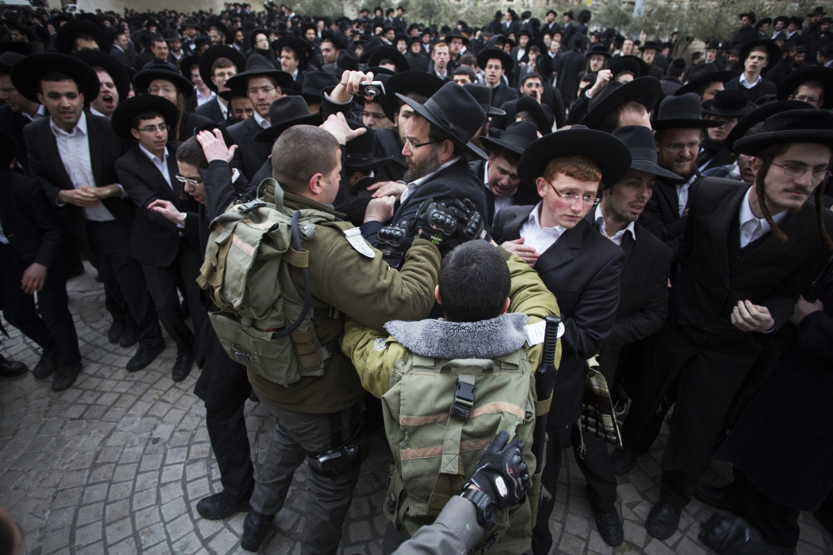 Israeli border policemen scuffle with ultra-Orthodox Jewish protesters during a demonstration in Jerusalem
