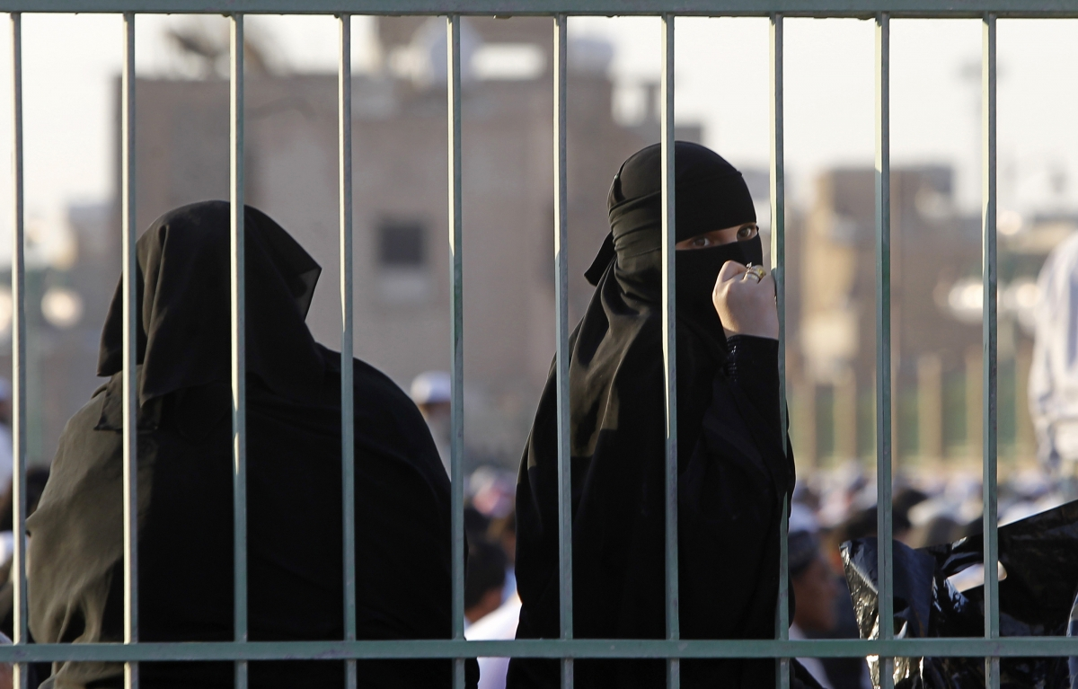 A Saudi woman looks back during prayers for Eid al-Adha in Riyadh
