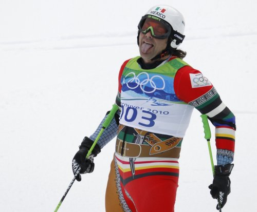 Mexico's Hubertus Von Hohenlohe sticks out his tongue after competing in the men's alpine skiing giant slalom event