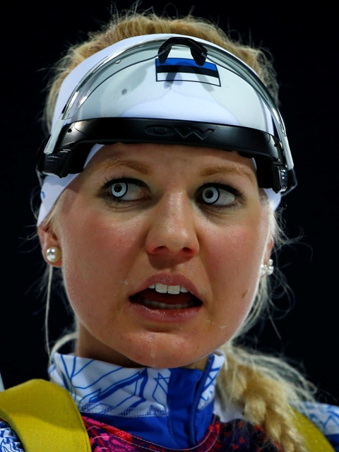 Estonia's Grete Gaim reacts after crossing the finish line during the women's biathlon 7.5km sprint event at the Sochi 2014 Winter Olympics in Rosa Khutor February 9, 2014.
