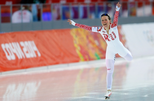 Russia's Olga Graf celebrates finishing third place in the women's 3,000 metres speed skating race