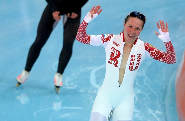 Olga Graf of Russia waves after her women's 3000 meters speed skating race