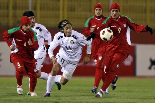 Women - or perhaps men, compete on the pitch for Iran against Jordan