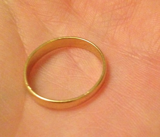 A gold wedding ring inscribed