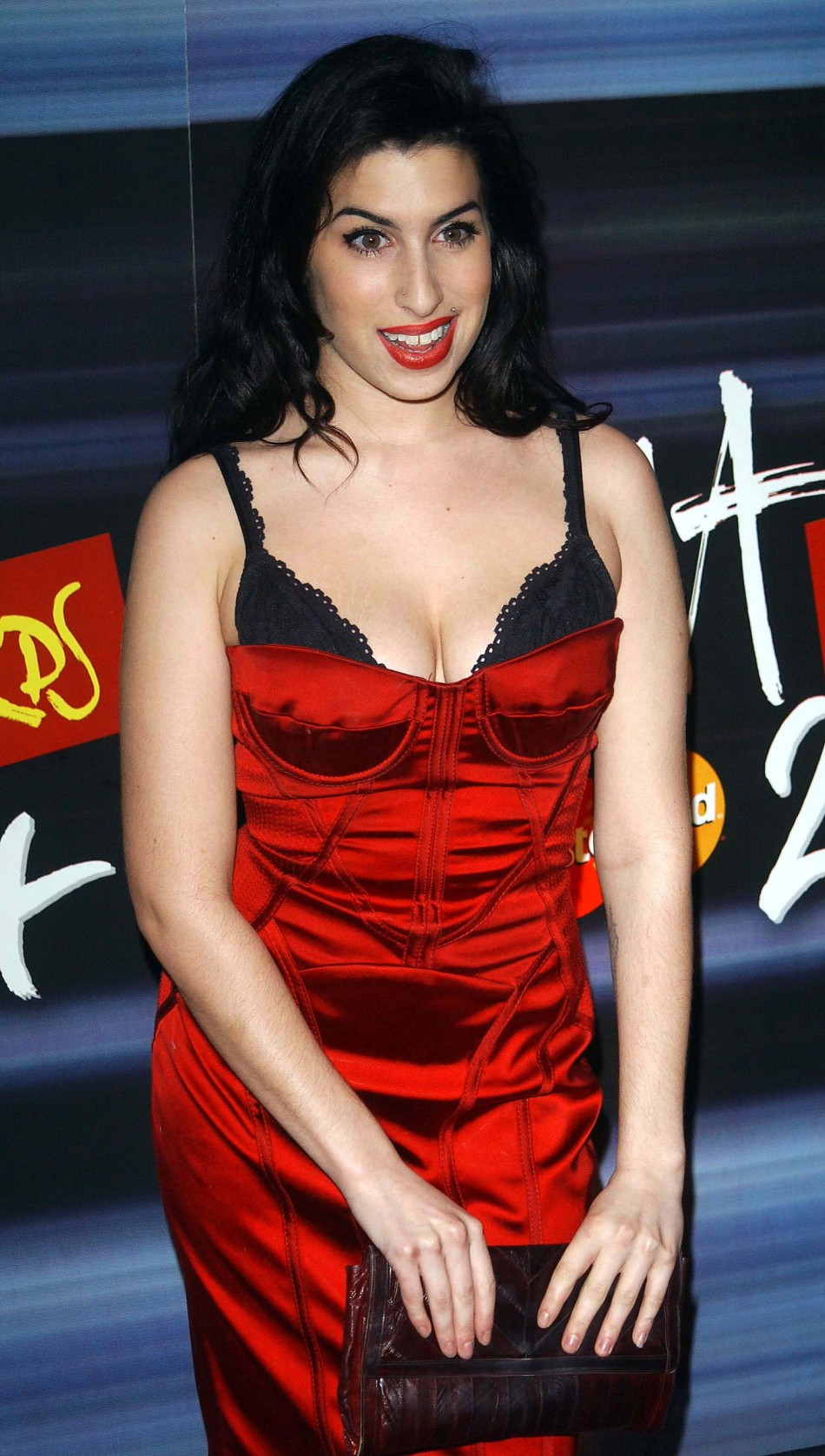 British jazz singer Amy Winehouse posed for photographers as she arrives at the 2004 Brit Awards nominations at the Park Lane Hotel, central London