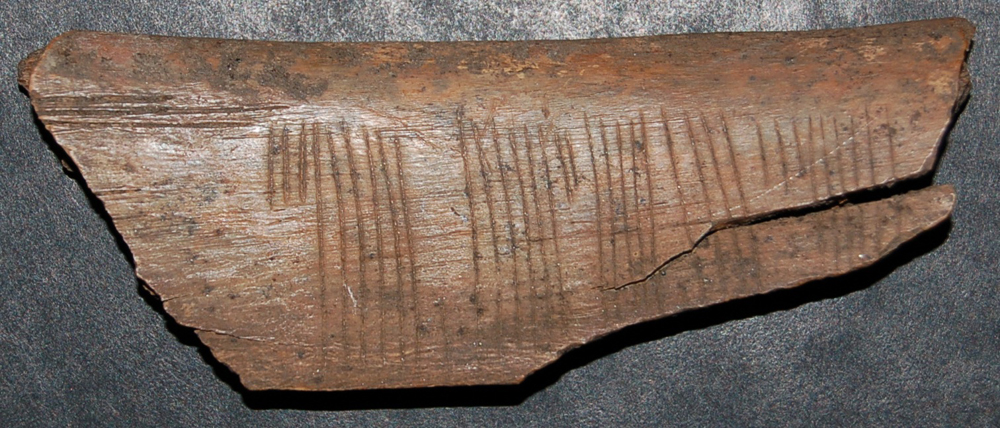 A Viking rune code on a 900-year-old piece of wood has been deciphered to say, 'Kiss Me'.