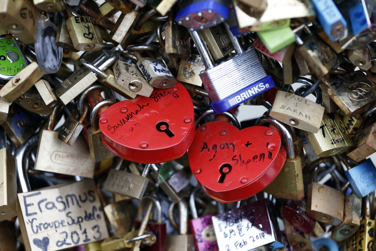 Thousands of padlocks clipped by lovers are seen on the fence of the Pont des Arts over the River Seine in Paris
