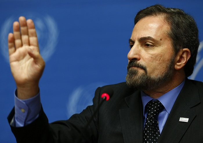 Spokesperson for the Syrian National Coalition Louay Safi addresses a news conference at the UN European headquarters in Geneva.