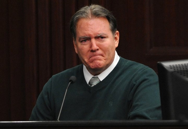 Defendant Michael Dunn reacts on the stand during testimony in his own defense during his murder trial in Duval County Courthouse in Jacksonville, Florida.