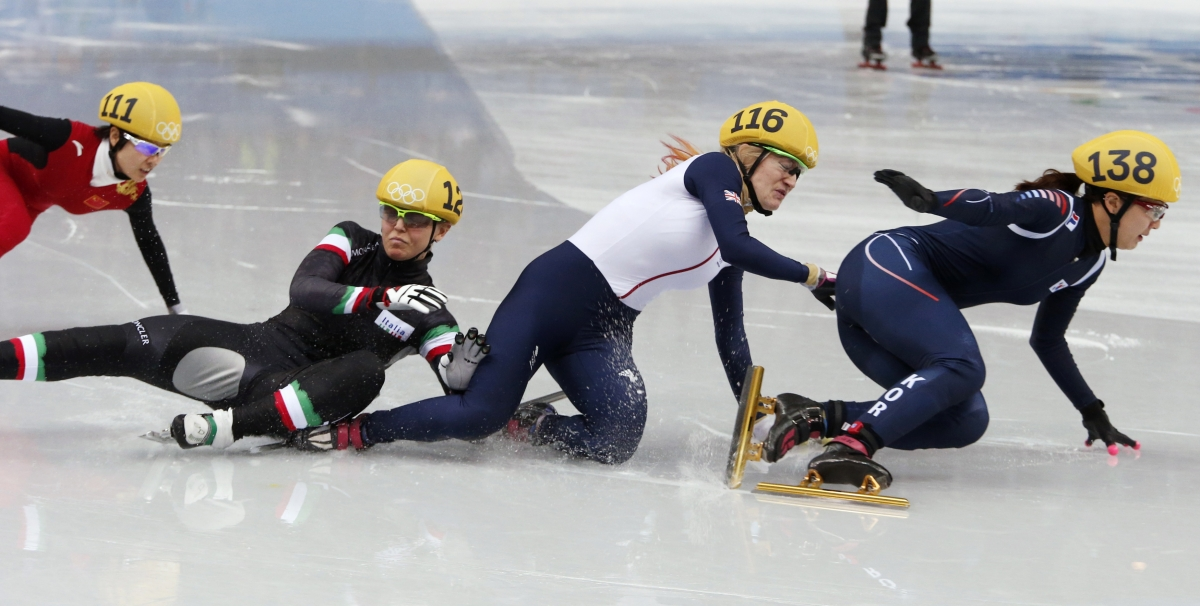 Italy's Arianna Fontana (2nd L), Britain's Elise Christie (2nd R), and South Korea's Park Seung-hi (R) crash, during the women's 500 metres short track speed skating final at the Sochi Winter Olympics