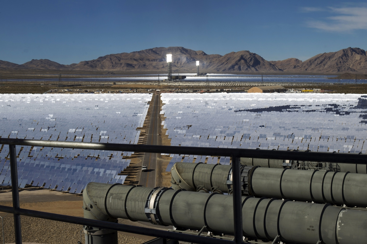 Heliostats reflect sunlight onto boilers in towers during the grand opening of the Ivanpah Solar Electric Generating System in the Mojave Desert near the California-Nevada border