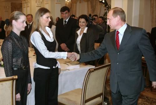 Russian President Vladimir Putin greets Alina Kabayeva at a meeting of Russian Olympians in 2004.