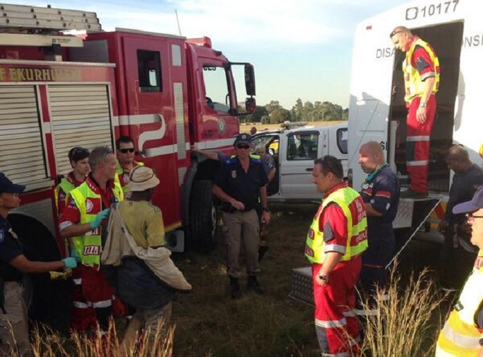 A rescued miner is examined by emergency services before being handed over to South African police.