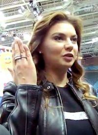 Kabayeva shows the ring to TV cameras.