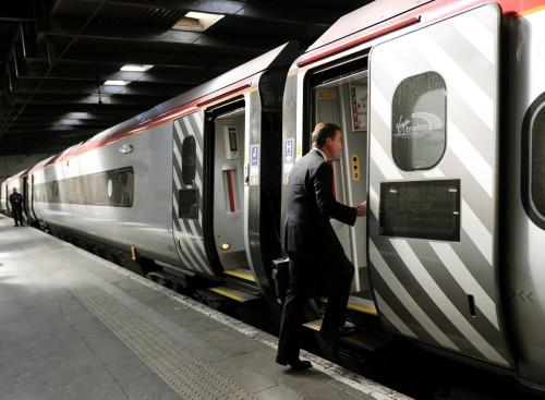 David Cameron boards train