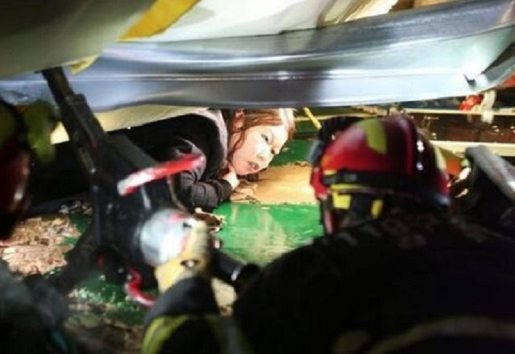 Fire crews help the trapped victims of a building collapse in South Korea