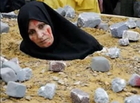A woman protests against stoning in a demonstration. The Isis stonings are reported to be the first executions of their kind carried out by Isis.