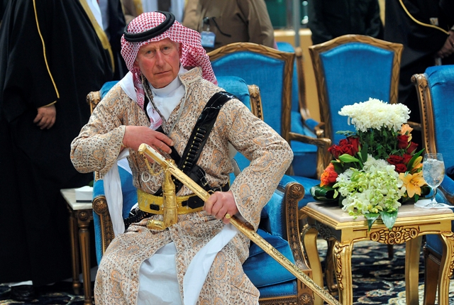 Britain's Prince Charles, wearing a traditional Saudi attire, attends the traditional Saudi dance
