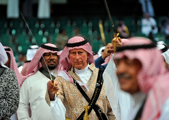 Prince Charles performing the traditional Saudi dance