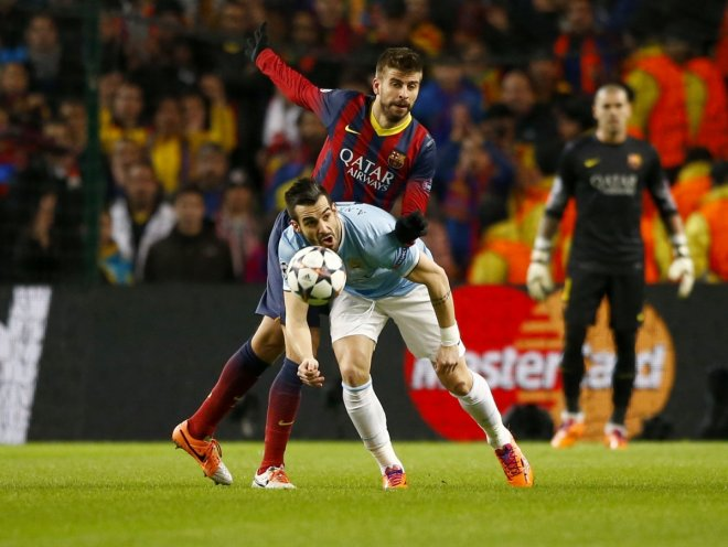 Alvaro Negredo was booked following a tackle to Pique.
