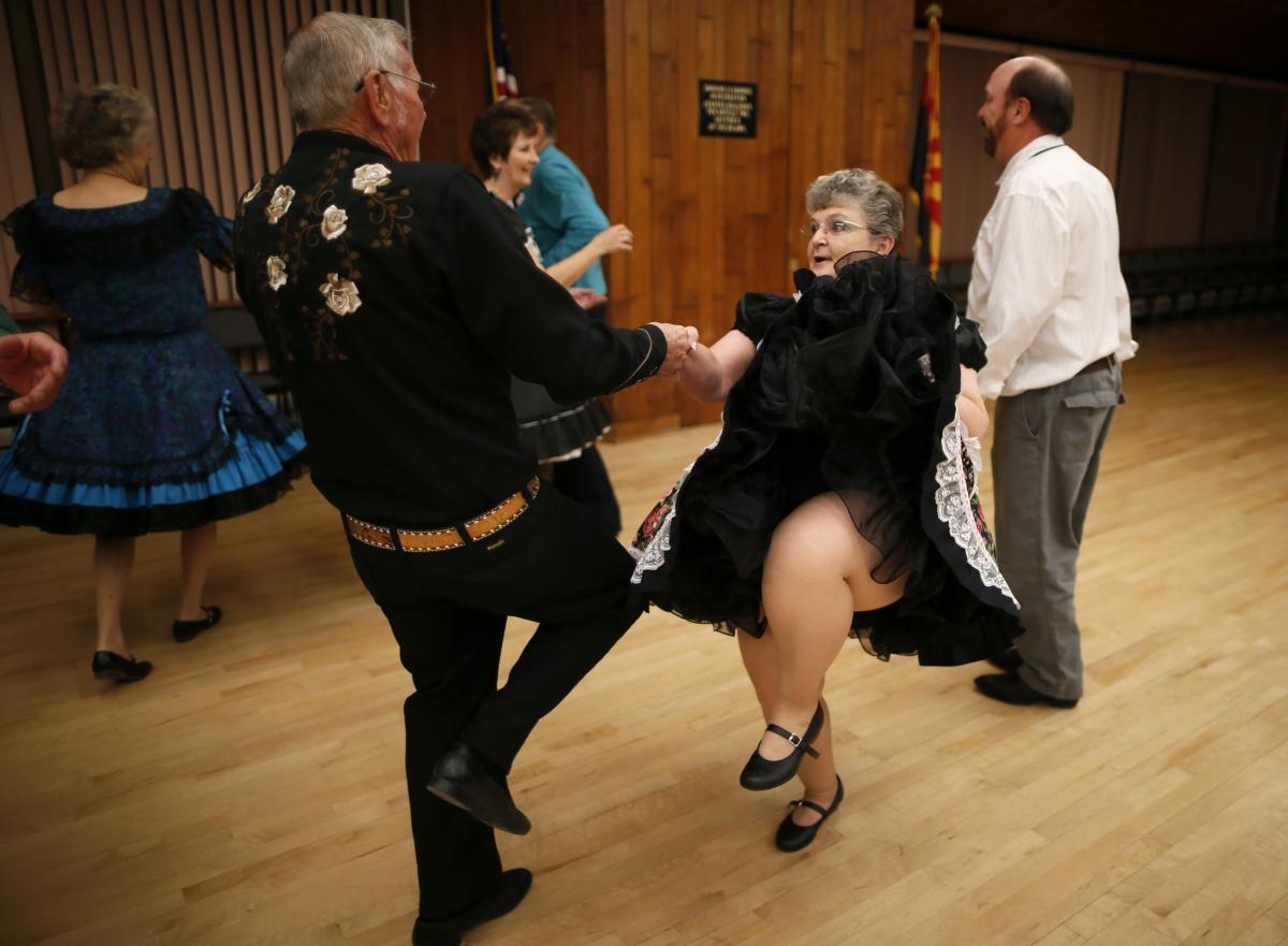 Dancing elderly couple