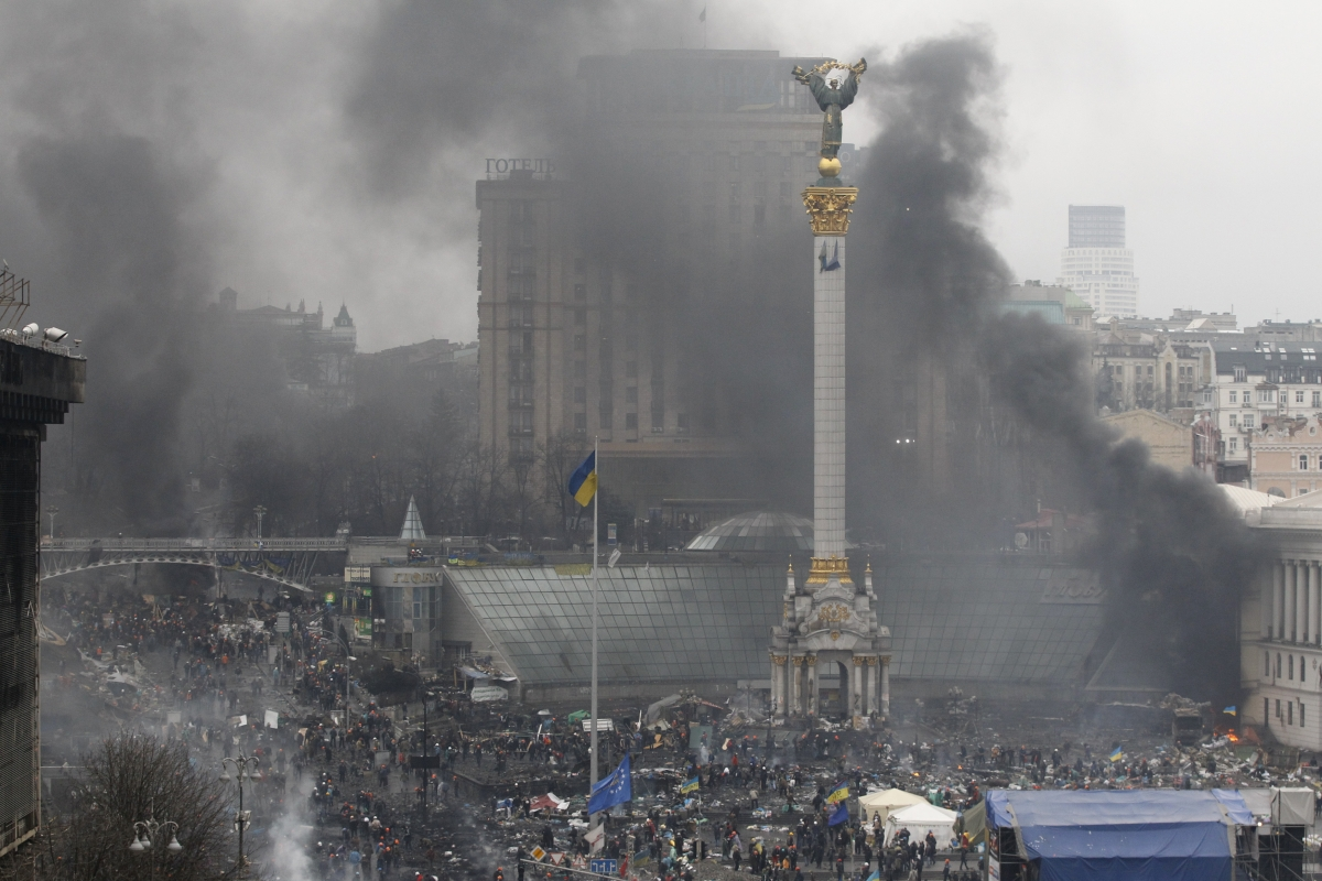 Smoke rises over Independence Square during clashes between anti-government protesters and riot police in Kiev