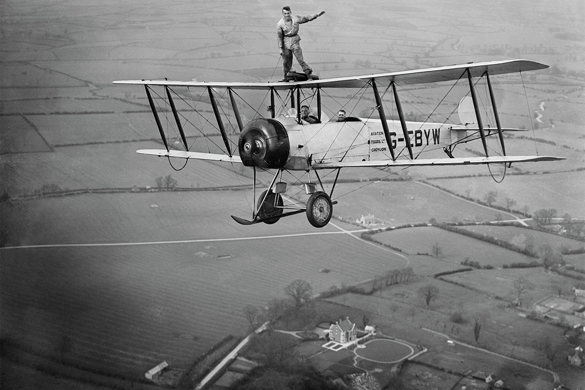 Martin Hearn wing walking on Aviation Tours Ltd Avro 504K G-EBYW, unlocated
