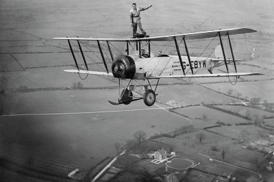 Martin Hearn wing walking on Aviation Tours Ltd Avro 504K G-EBYW, unlocated
