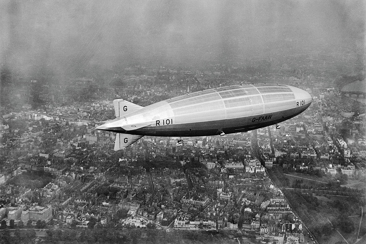The R101 airship on its first test flight, Westminster, from the west, 1929