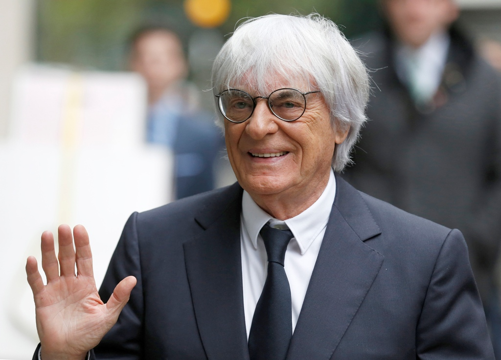 A British judge dismisses a claim against Bernie Ecclestone on 20 February but says he paid a bribe.