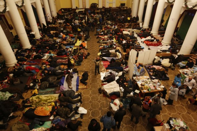 Anti-government protesters sleep in City Hall in Kiev