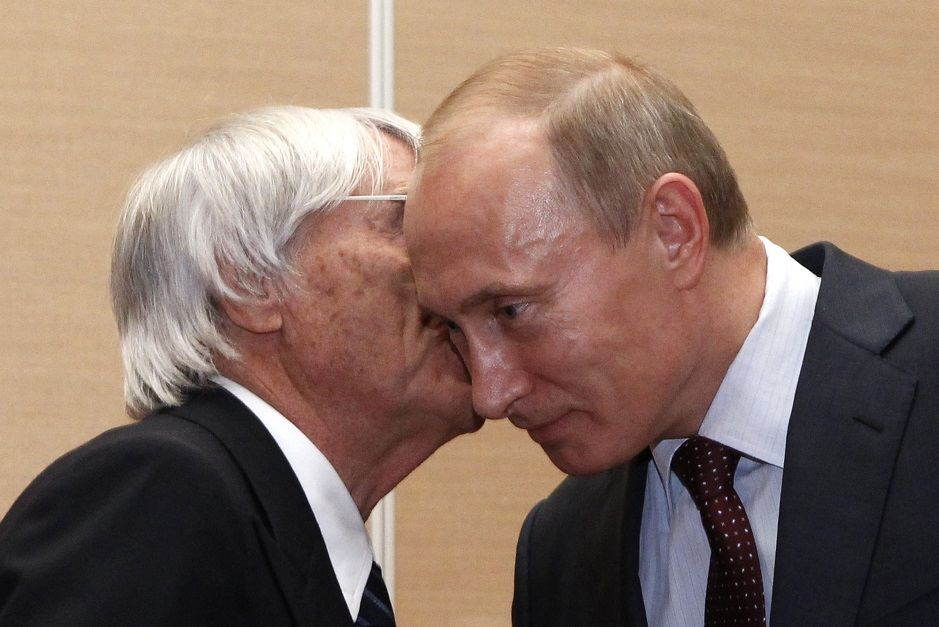 So close: Bernie Ecclestone and Vladimir Putin share a personal moment